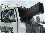Lucky trucker unharmed as steel beams crash through semi cab