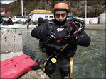 Man learns diving to look for wife lost in Japan tsunami