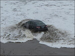 Photos: Car gets stuck on Lincoln City beach
