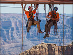 Workers dangle from ropes to clean Grand Canyon Skywalk glass