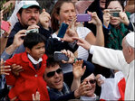Pope poses for 'selfies' after Palm Sunday homily
