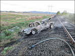 Deputies: Drunk driver crashes into moving train