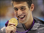 Phelps says swimming on hold after DUI arrest