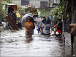 Typhoon kills 12 in Philippines, spares Manila