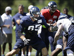 Lynch practices, right tackle battle wide open