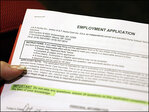 U.S. jobless aid applications rise to 311,000