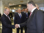 Putin meets with Ukraine's leader as fighting widens