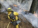 Man arrested in fast-growing California wildfire