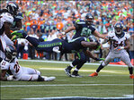 Wilson, Lynch power Seahawks to thrilling OT win over Broncos