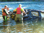 SUV in river since May pulled to shore