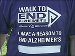 People don purple, pack Alton Baker Park paths for Alzheimer's Walk