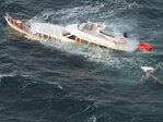 Coast Guard rescues 2 from sinking ship