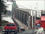 Wind delays repairs to Hwy 101 bridge closed after death, damage