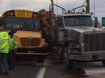 Kids OK after bus collides with loaded log truck