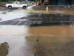 Water line break lifts road, causes cloudy water