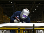 U.S. factory growth slips in November but still healthy