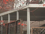 Anonymous carport crusader puts Springfield homeowners on spot