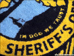 'In Dog We Trust' accidentally printed on sheriff's rugs
