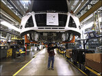 Global watchdog turns a bit more rosy on world economy