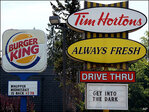 Burger King, Tim Hortons parent reports loss on deal costs