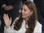 Photos: Pregnant Duchess Kate visits daycare, racing team HQ