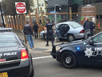 Car fleeing police crashes in front of brewery