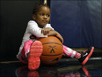 Coach's adopted toddler builds a life with hoops team