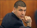 Aaron Hernandez still flashes swagger, smile at murder trial