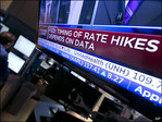 Fed rate hike expectations shake up stocks, bonds and dollar