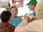 Campaigning Hillary Clinton says economy has 'stalled out'