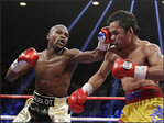 Mayweather nixes rematch rumors, calls Manny Pacquiao a 'coward'