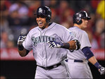 Cruz hits 14th HR, Hernandez pitches Mariners past Angels