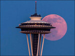 Full moon teams up with Space Needle for dramatic photographs