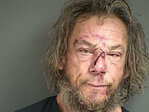 Police: Man arrested after crawling through window of occupied motel
