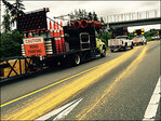 Paint-striper malfunction leaves bright yellow trail down I-5