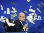 FIFA's Blatter showered with fake money during comedian stunt