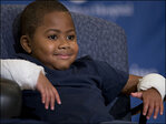 Boy who lost limbs to infection gets double-hand transplant