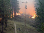 Firefighters work to protect homes, power, roads near John Day