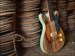 Student fashions fancy guitars out of old skateboards
