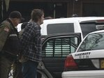 Police raid Roseburg home after elderly man attacked