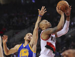 Warriors clinch division with 122-108 victory over Blazers