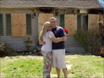 Couple marries in front of burned home
