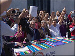 Immigrants cheer signing of driver&apos;s card bill