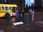 Man trapped under bus freed with minor injuries