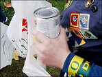 Scouts go door-to-door collecting cans for the hungry
