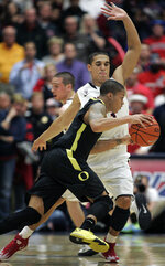 Ducks downed in Tucson, 67-65
