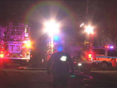 Arcing power lines delay response to house fire; 7 people displaced