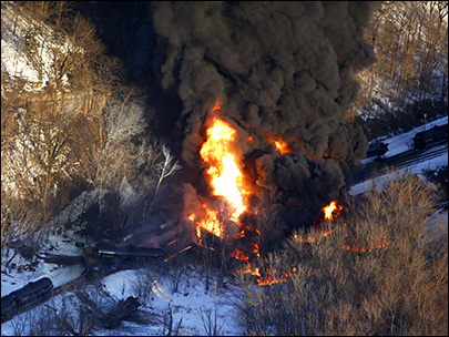 Train carrying crude oil derails, explodes near Illinois city