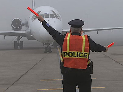 On eve of retirement, officer asks to marshal plane at airport
