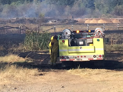 Oak Hill School evacuates as grass fire burns near LCC